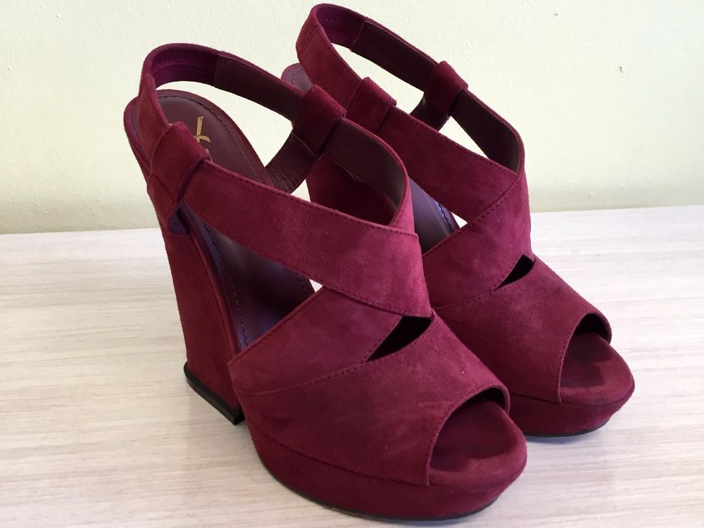 I seem to be craving burgundy this fall. Way too high for me but I can still fall in love. YVES SAINT LAURENT BURGUNDY WEDGE SANDALS, 38 #YSLYvesSaintLaurent #PlatformsWedges