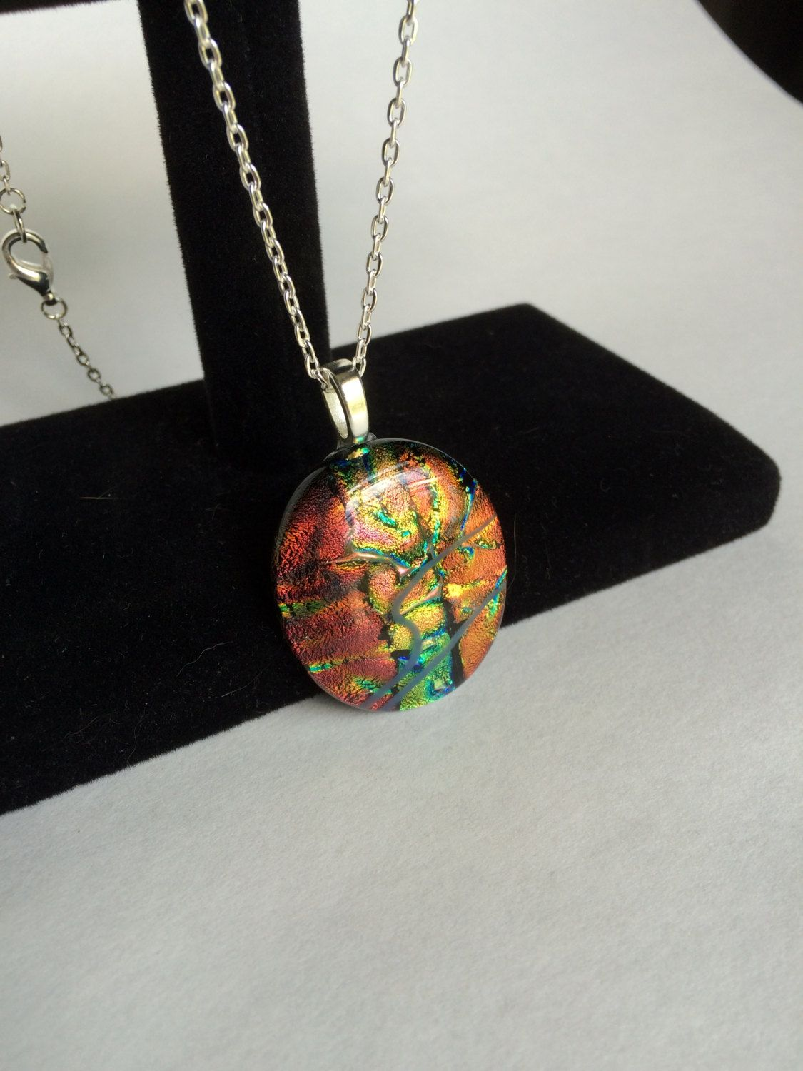 Oval Orange, Yellow, and Green Dichroic Glass Pendant by starlingstudiosix on Etsy