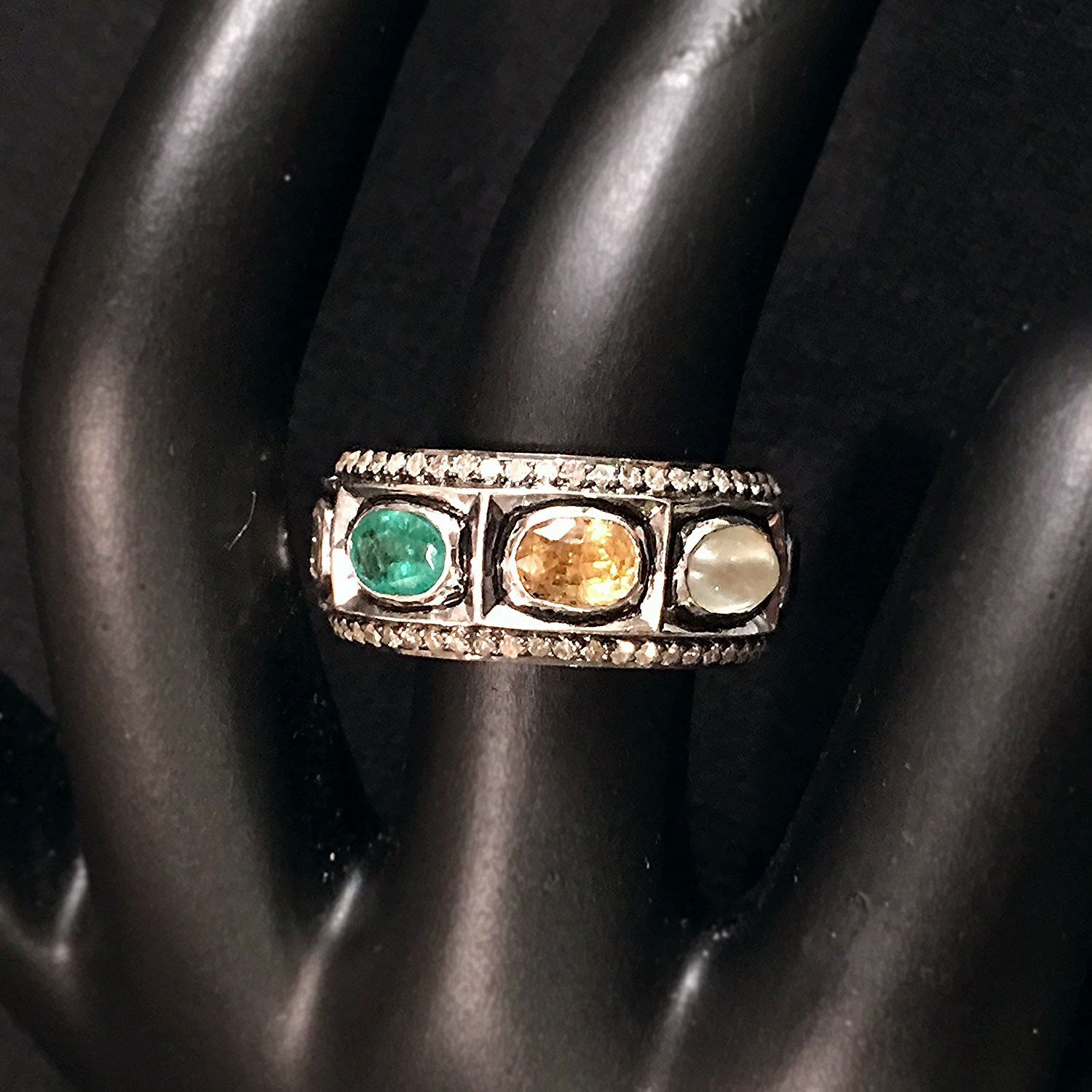 Navaratna Ring  $1,550  Featuring The 9 Astrological Gems (ruby, Pearl,  Red