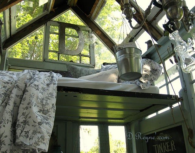 this is a little house out in the garde with a little loft to lay and read in- cozy!