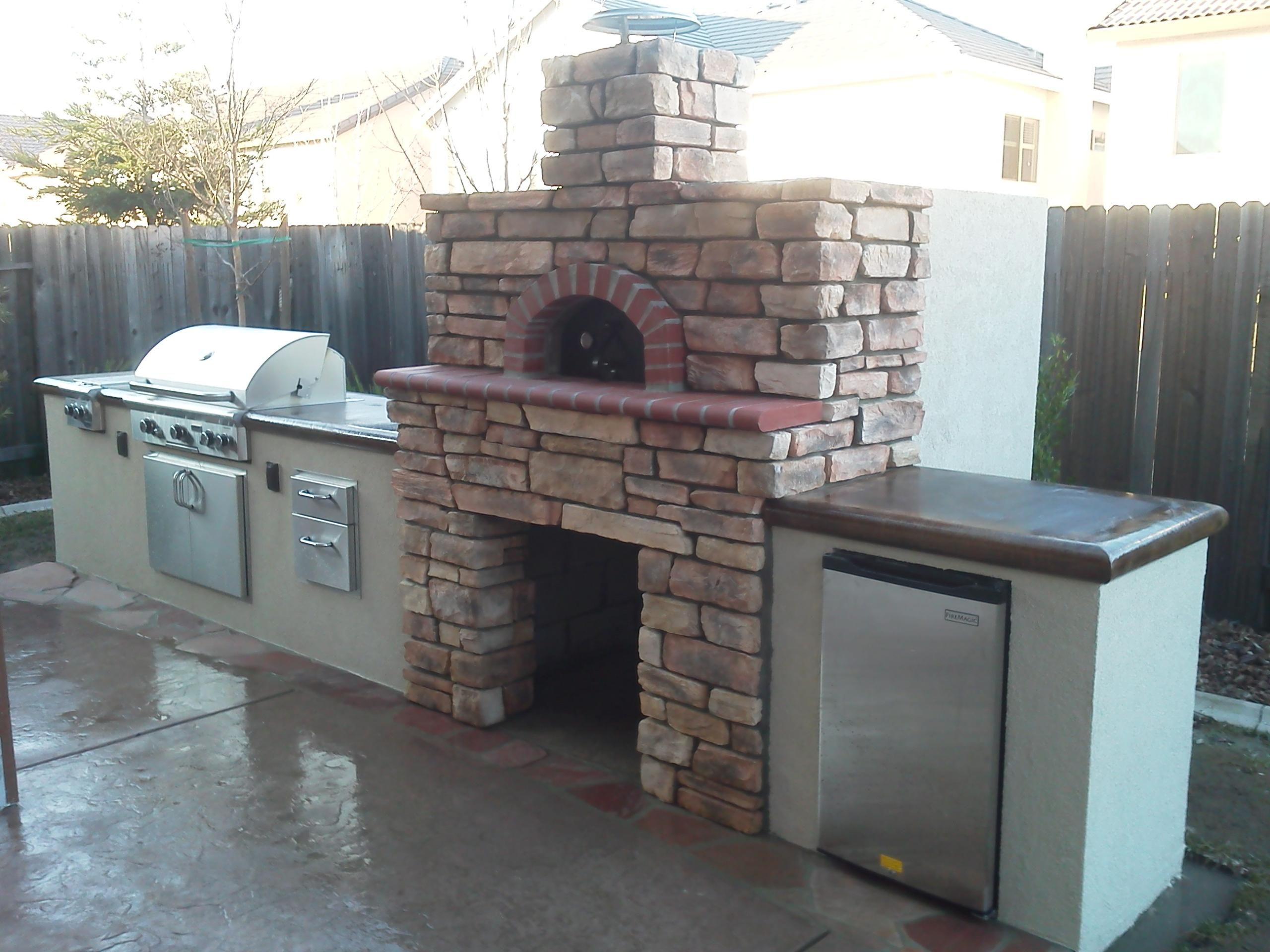 outdoor kitchen with a wood fired pizza oven gb stoneworks