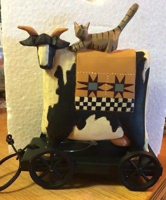 williraye studio folk art figurine cat riding a cow pull