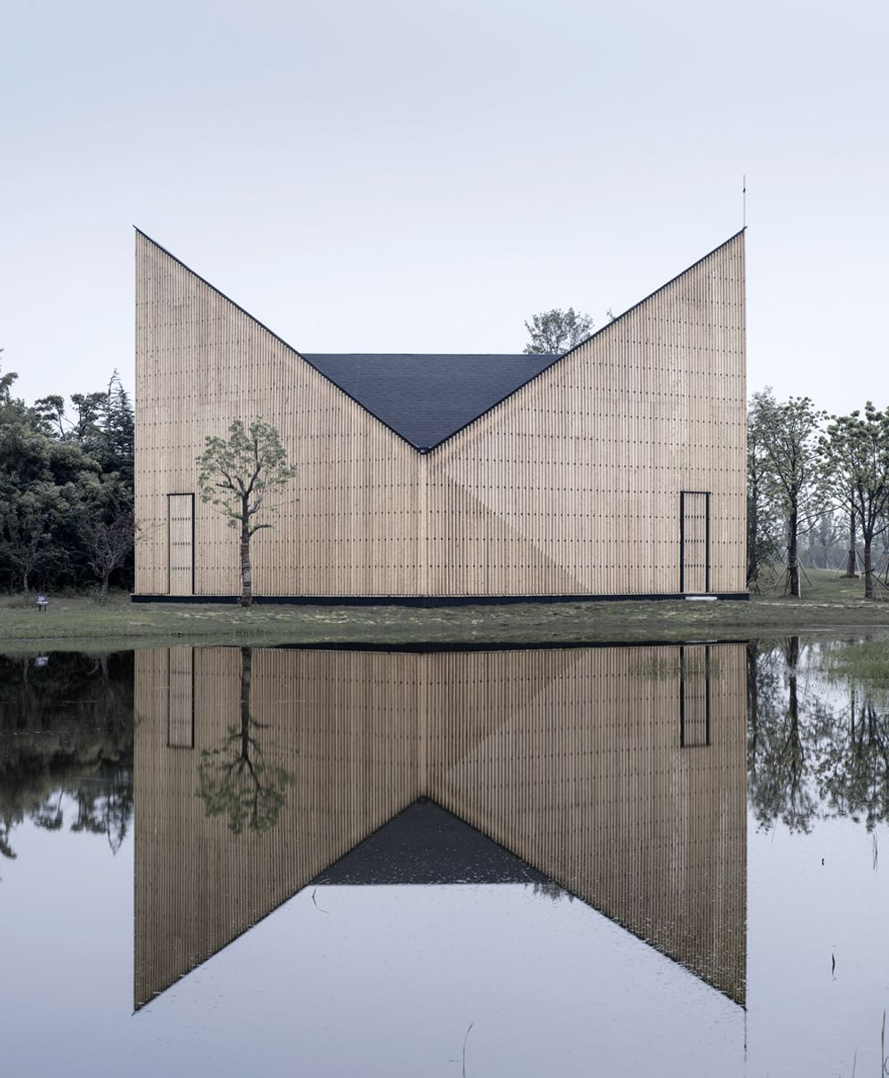 Vertical lengths of timber mask the interior of this chapel designed by AZL Architects in eastern China