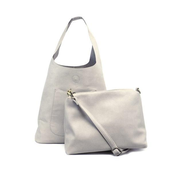 0acb746506f6 This lovely slouchy hobo bag has a top snap closure and convenient front  exterior pocket.
