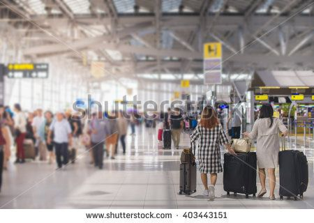 Woman Carries Luggage At The Airport Terminal Airport Travel Airport Check In Travel