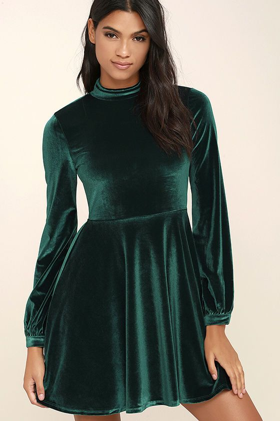 d0fed2c9609 ... Embrace the Present Forest Green Velvet Skater Dress! Soft and stretchy  velvet shapes a mock neck with double covered button closure and sexy open  back.