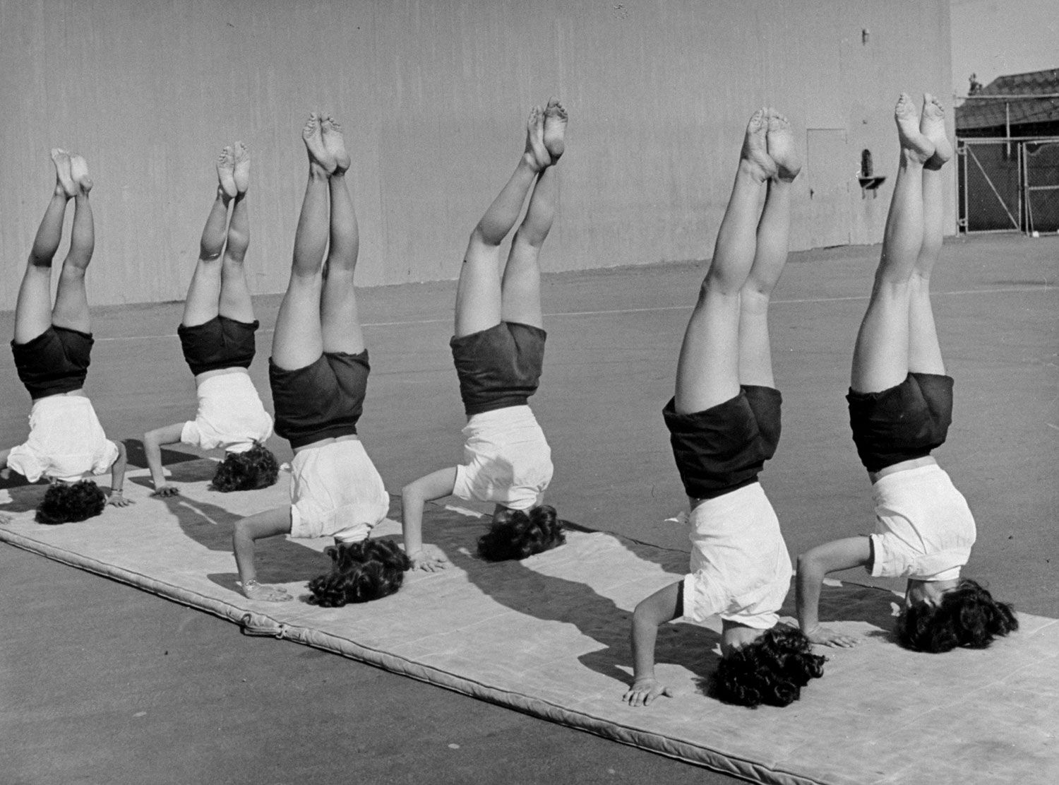 Girls From Hoover High School Stand On Their Heads In Gymnastics Class 2c San Diego 2c California 2c 1946 Jpg Hoover High School Yoga Photos Gymnastics Class