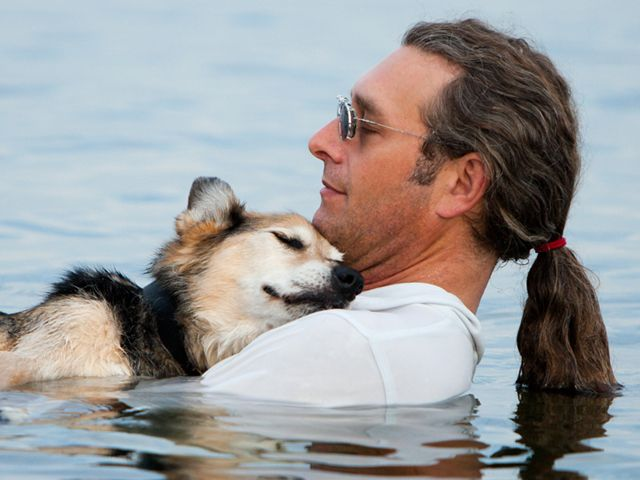On the news yesterday, (June 19, 2013) that Schoep, the 20 year old dog that suffered from arthritis, who gained worldwide attention from this photograph, which showed how his pain was eased by floating to sleep in owner's arms,has died. R.I.P. Schoep.