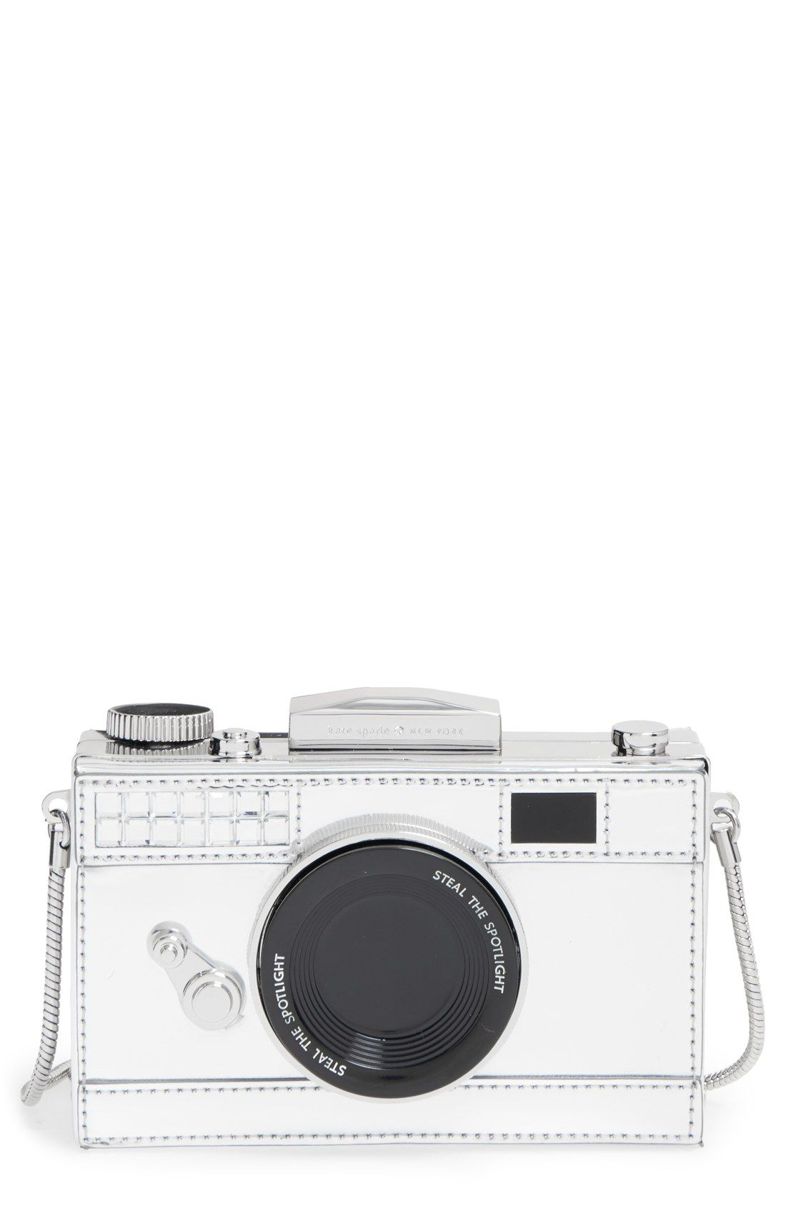 Stealing the scene with this silvery camera frame clutch from Kate ...