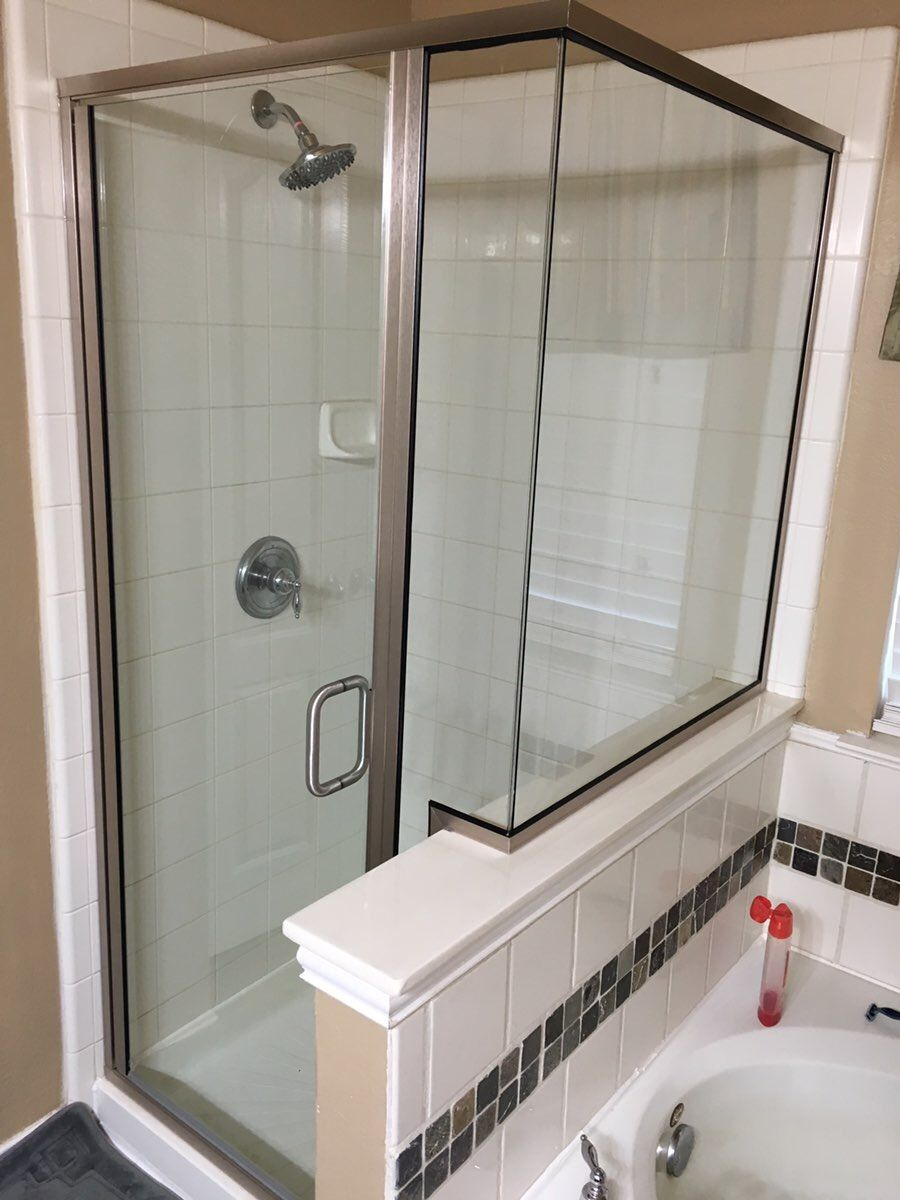 Semi- Frameless shower with a frameless glass to glass corner and BM ...