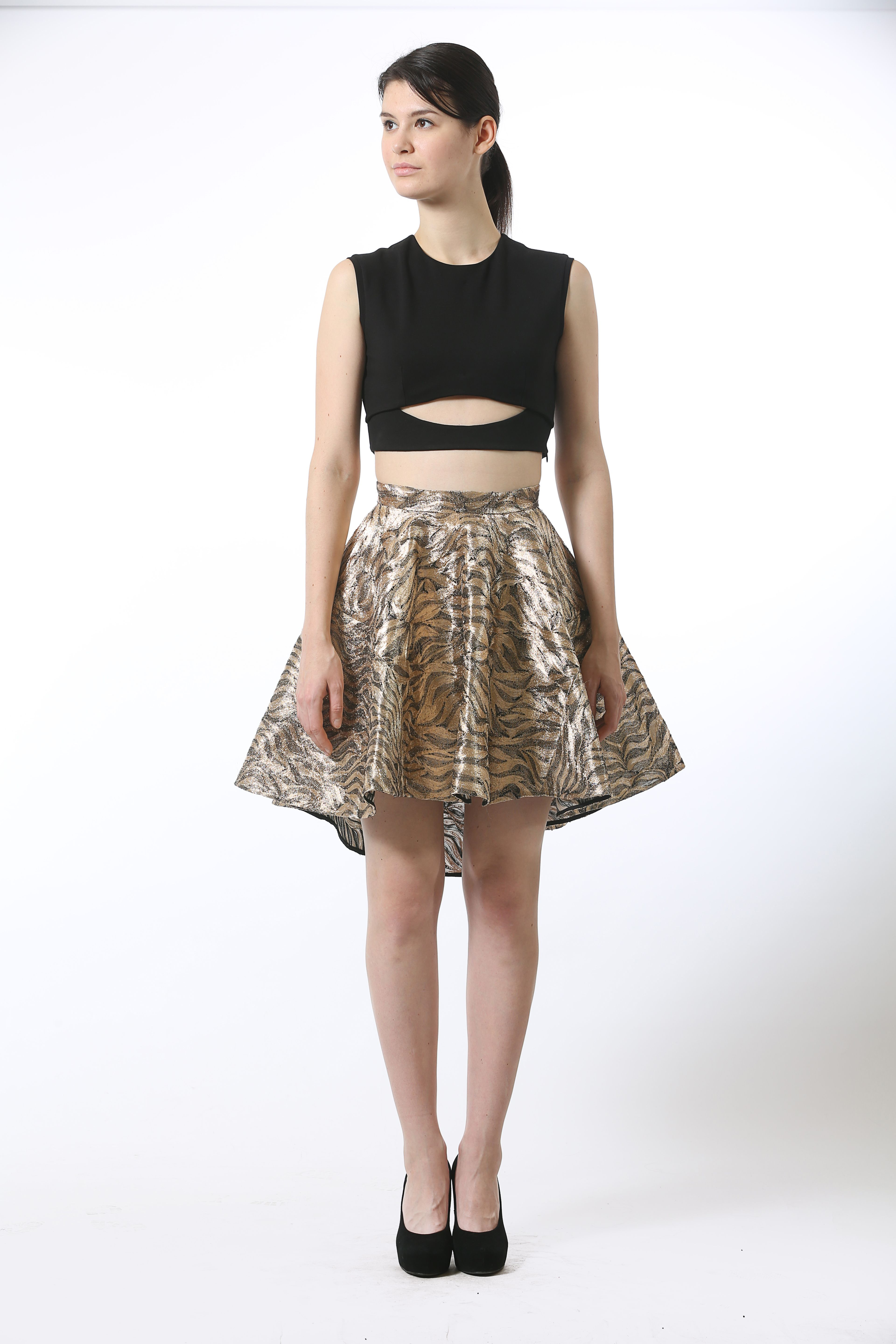 2eb8be6fc15 TOP  Lycra jersey crop top featuring a cut-out detail and an off center  conceal zip bone detail. BOTTOM  Gold metallic embroidered silk organza  skater skirt ...