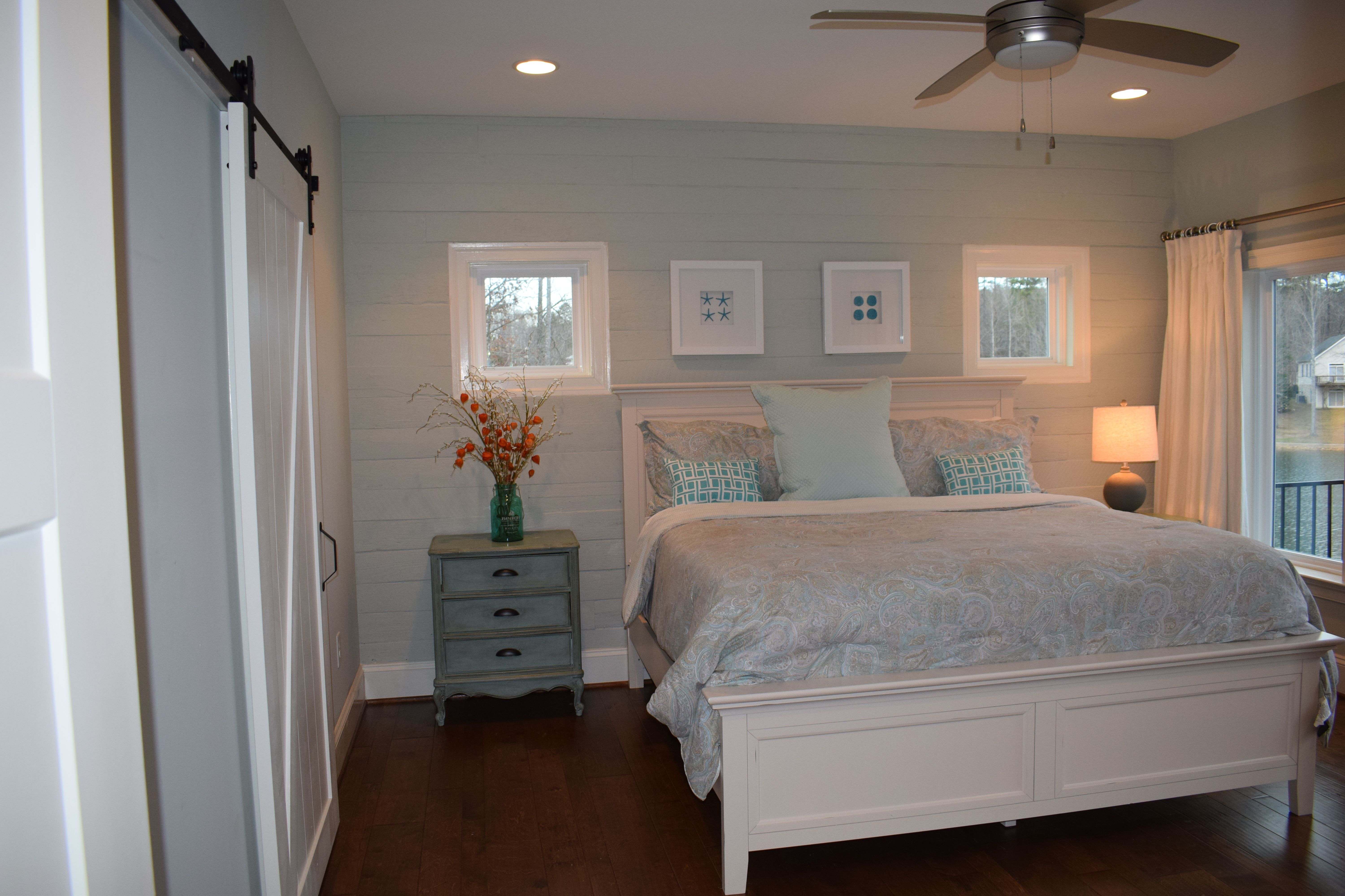 Reclaimed wood wall in master bedroom painted in Sherwin Williams