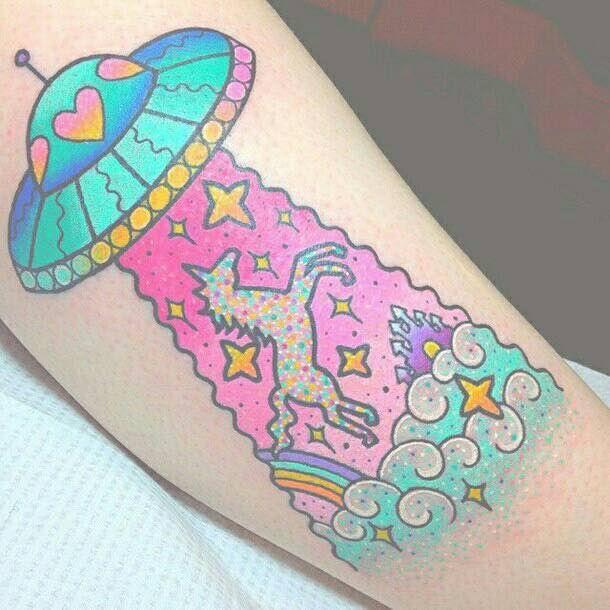 Alien and unicorn tattoo