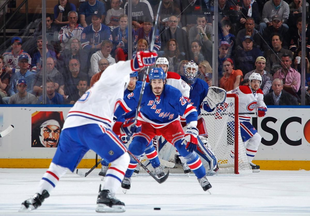NEW YORK, NY - MAY 25:  Henrik Lundqvist #30 of the New York Rangers watches as P.K. Subban #76 of the Montreal Canadiens takes a shot on goal in the first period of Game Four of the Eastern Conference Final during the 2014 NHL Stanley Cup Playoffs at Madi
