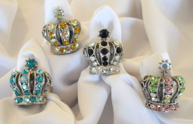 Our Royal Crystal Crown Ring is available in 4 different colors. Black, Amber, Multi, Aqua. Adjustable size.SKU:JR104
