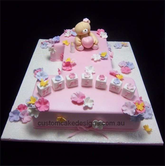 This Large Cake Was Made As A First Birthday Cake Featuring A