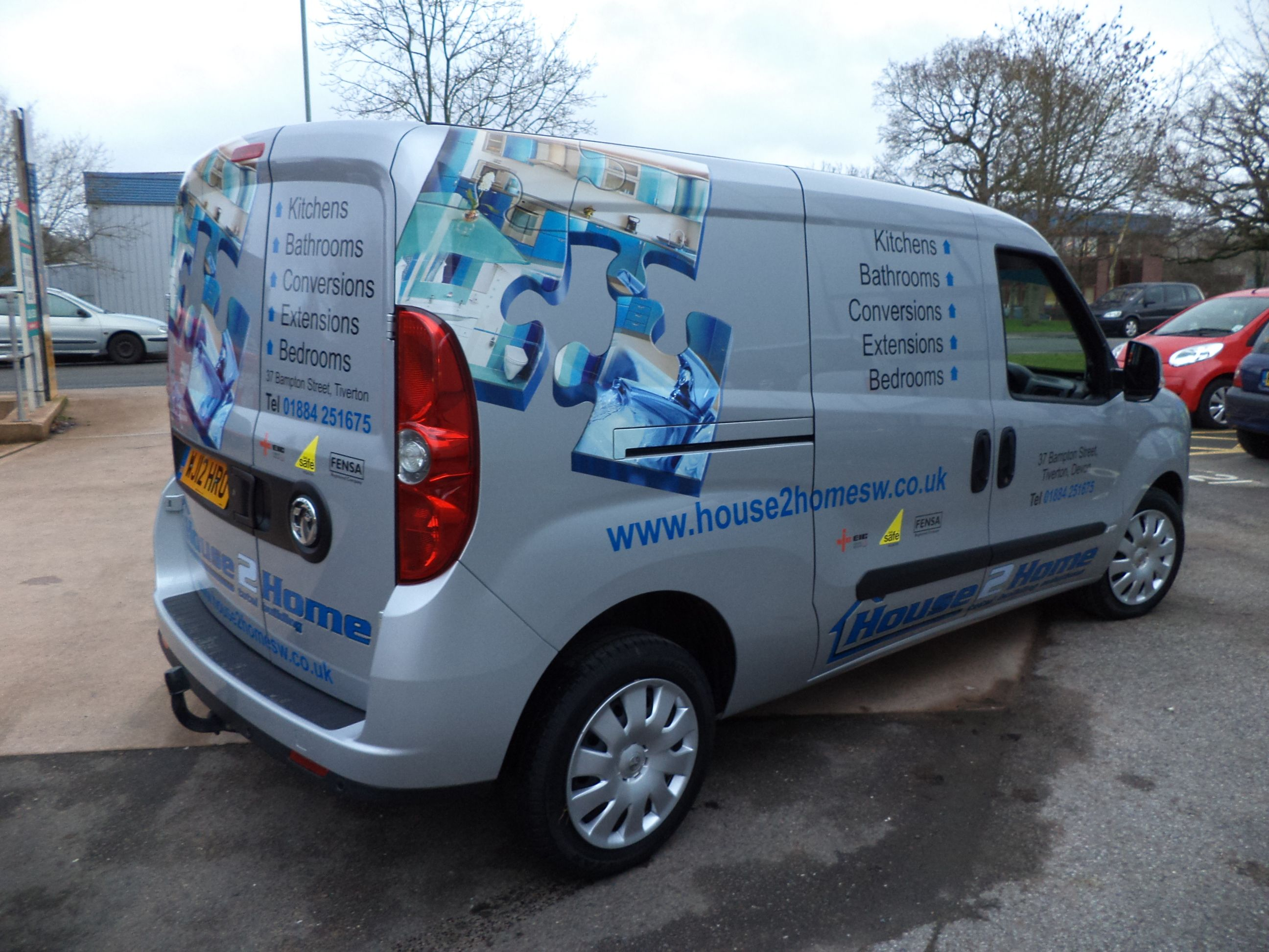Corporate Branded Vehicle Graphics Applied To Both Sides And Rear