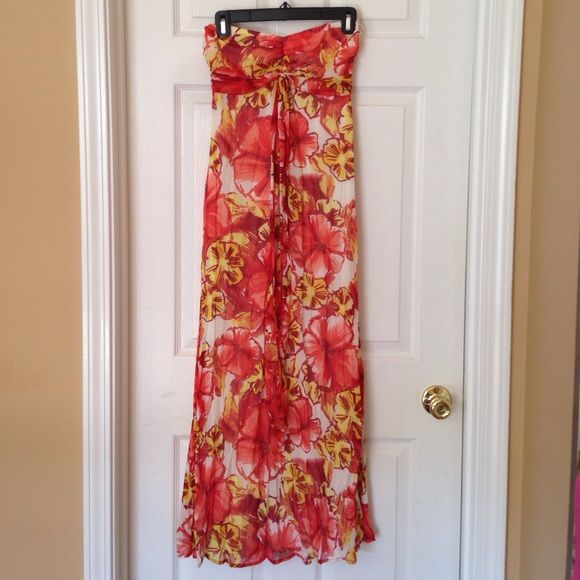 Beautiful floral print maxi dress!!  Fully lined coral and yellow floral maxi dress. It can be worn as a halter top dress pic 3 or tube top and sash tied around bust area pic 4. There is elastic stretch in bust area. This was worn once on vacation. Spring break or summer ready!!!☀️ Xhilaration Dresses Maxi