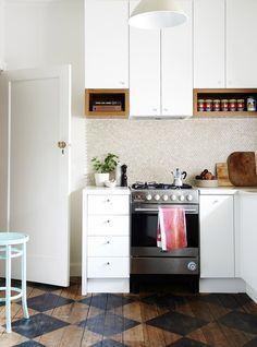 Penny Rounds backsplash.  Melbourne Home · Adelaide Daniell, Fraser Daniell and Harry Scott   The Design Files