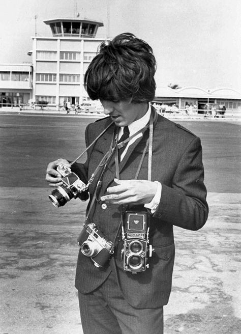 George Harrison with (left to right) A Nikon F, A  Kodak Retina IIS and his Rolleiflex.