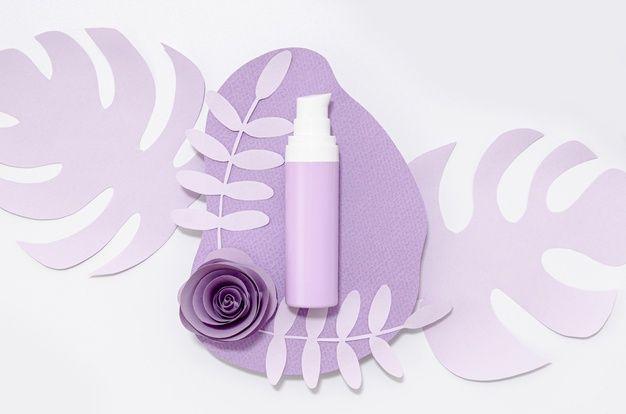 Purple skincare product on purple leaves  Free Photo