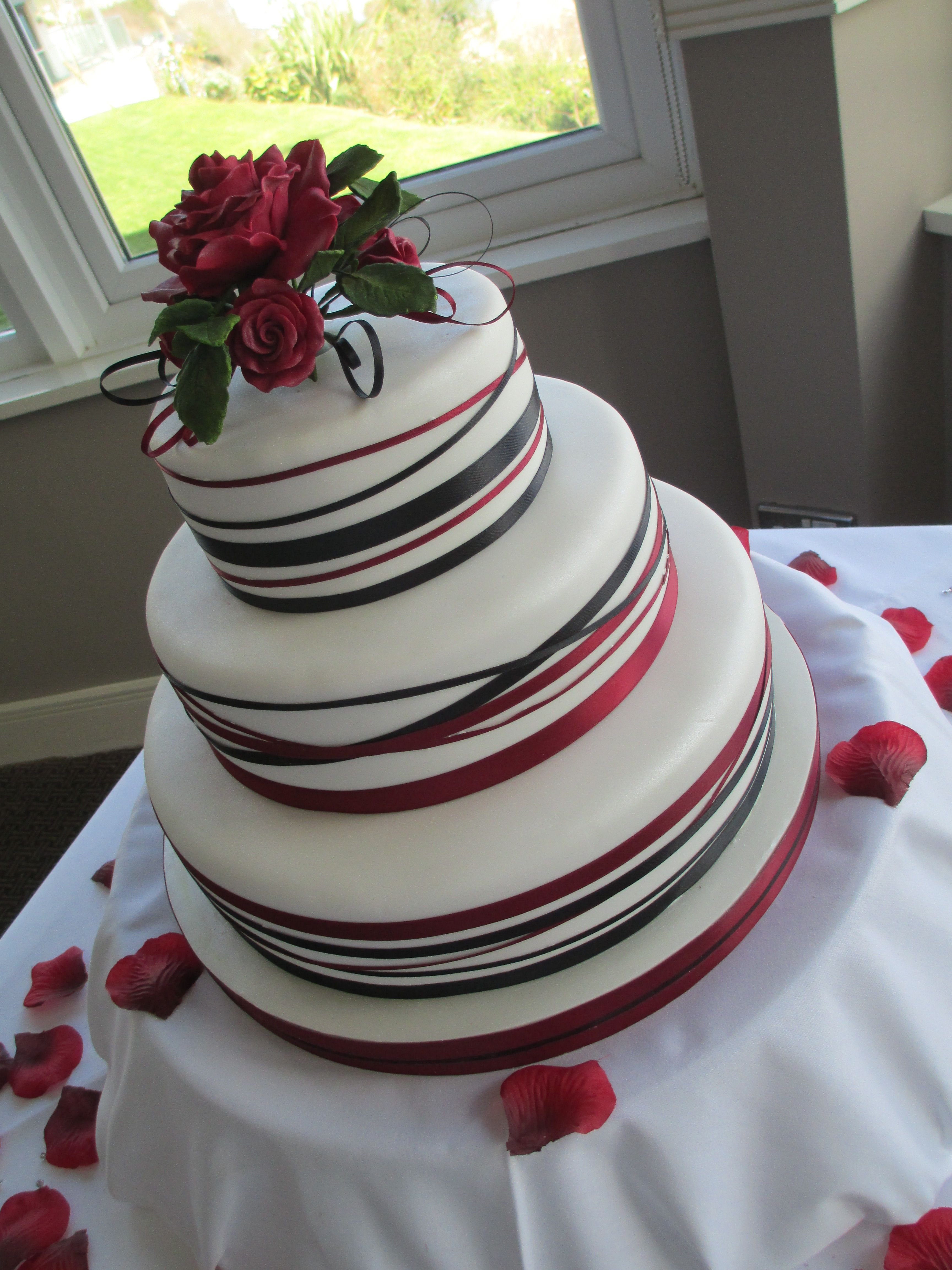 White red and black ribbon wedding cake with sugar roses | cakes ...