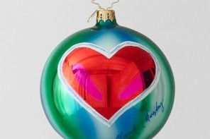 Red heart on green globe ornament