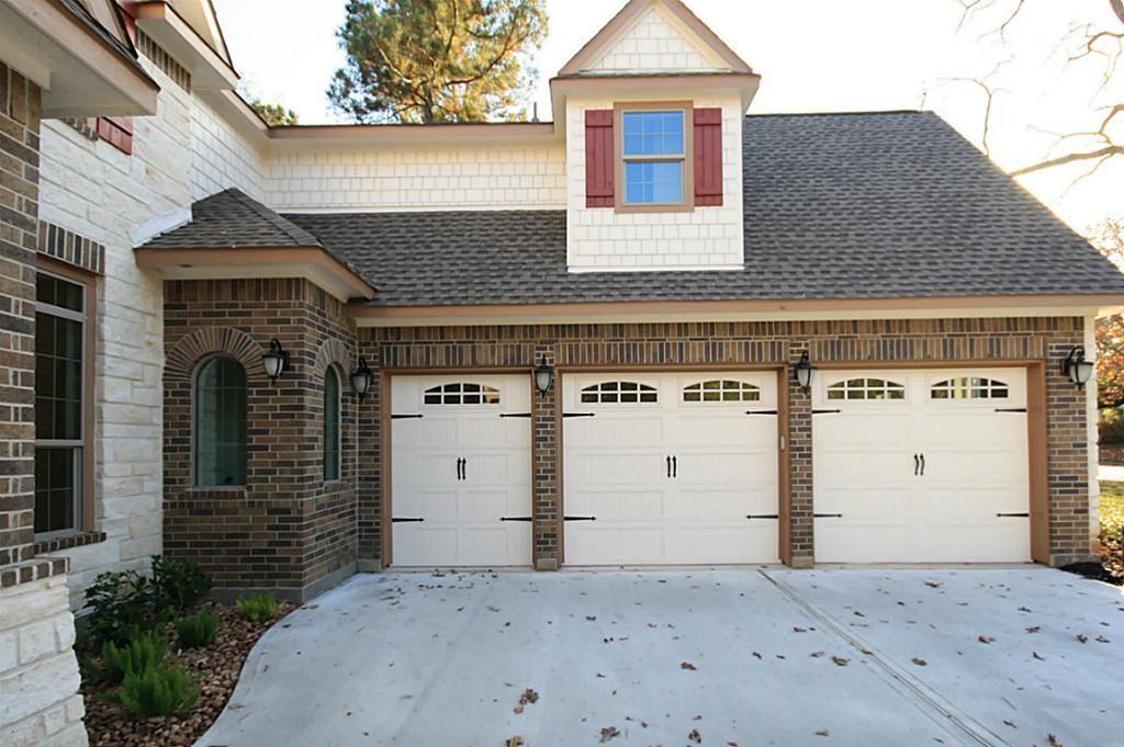 Three car garage 2 full bays and 1 golf cart bay golf for Golf cart garage door dimensions