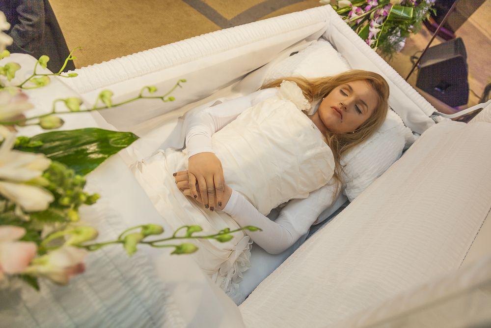 liana kotsura in her open casket during her funeral