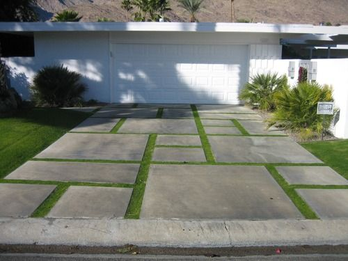 A geometric design of concrete and grass adds visual for Concrete driveway designs