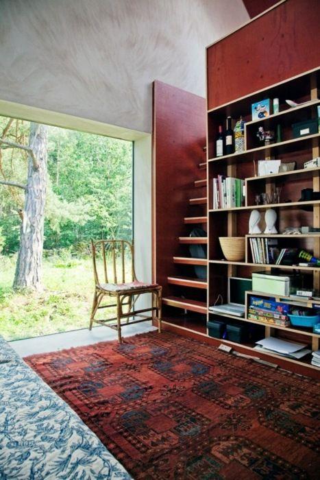 home of architect Morten Johansson, Sweden ....shelving / burgundy / persian rug