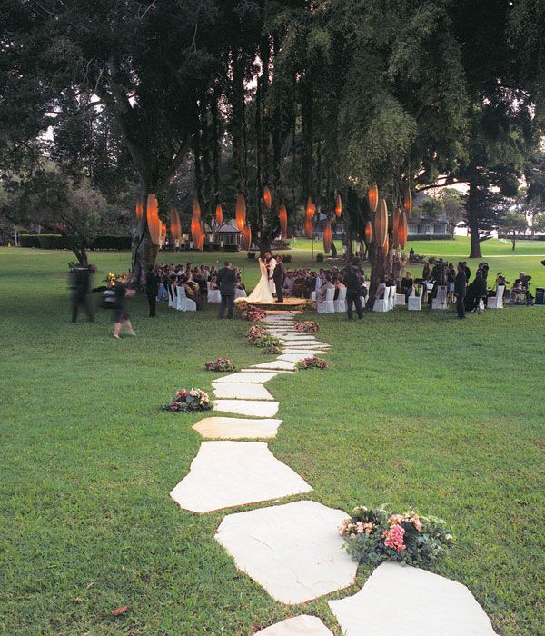 A charming flagstone path leads the bride to a ceremony in the round.