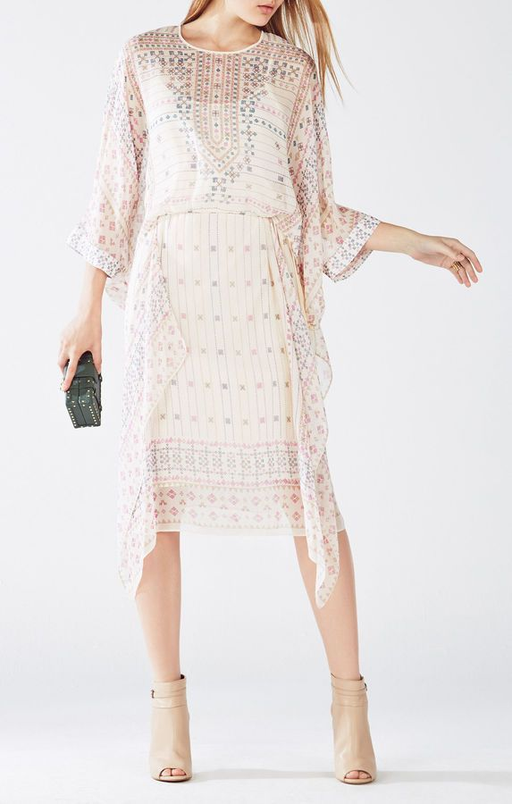 bohemian chic reign supreme with this relaxed silhouette, crafted from featherweight georgette featuring a St. Petersburg-inspired embroidered print in understated navy and pink. Jaelyn Scarf Print Dress