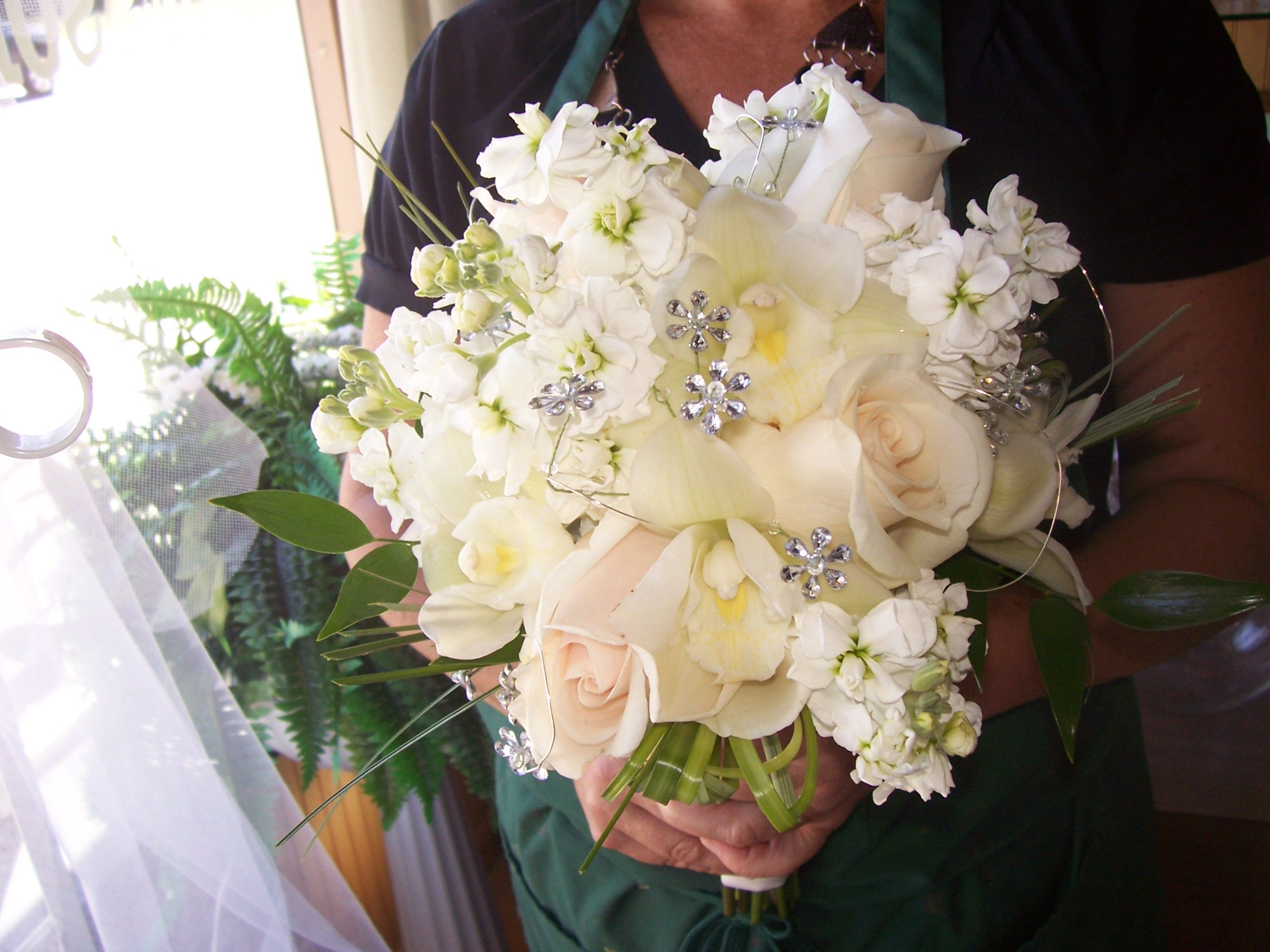 Bridal Bouquet With Creme Roses White Stock Cymbidium Orchids And Lots Of