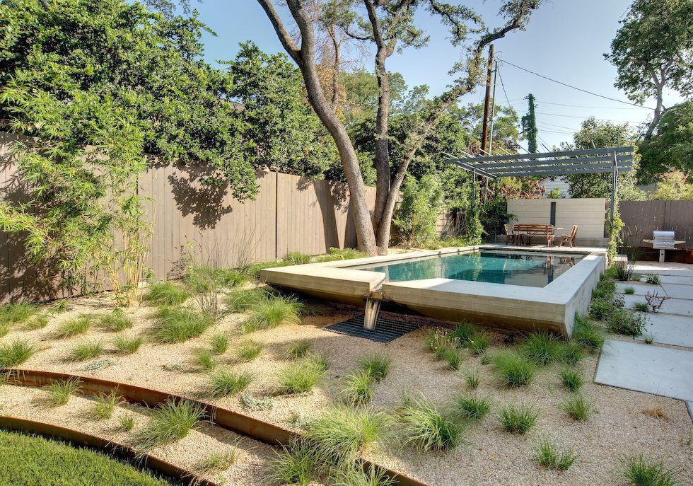 A Great Pool Idea For A Sloping Yard Hats Off To D Crain Austin Landscaping Sloped Garden Modern Garden Landscaping Backyard Ideas For Small Yards