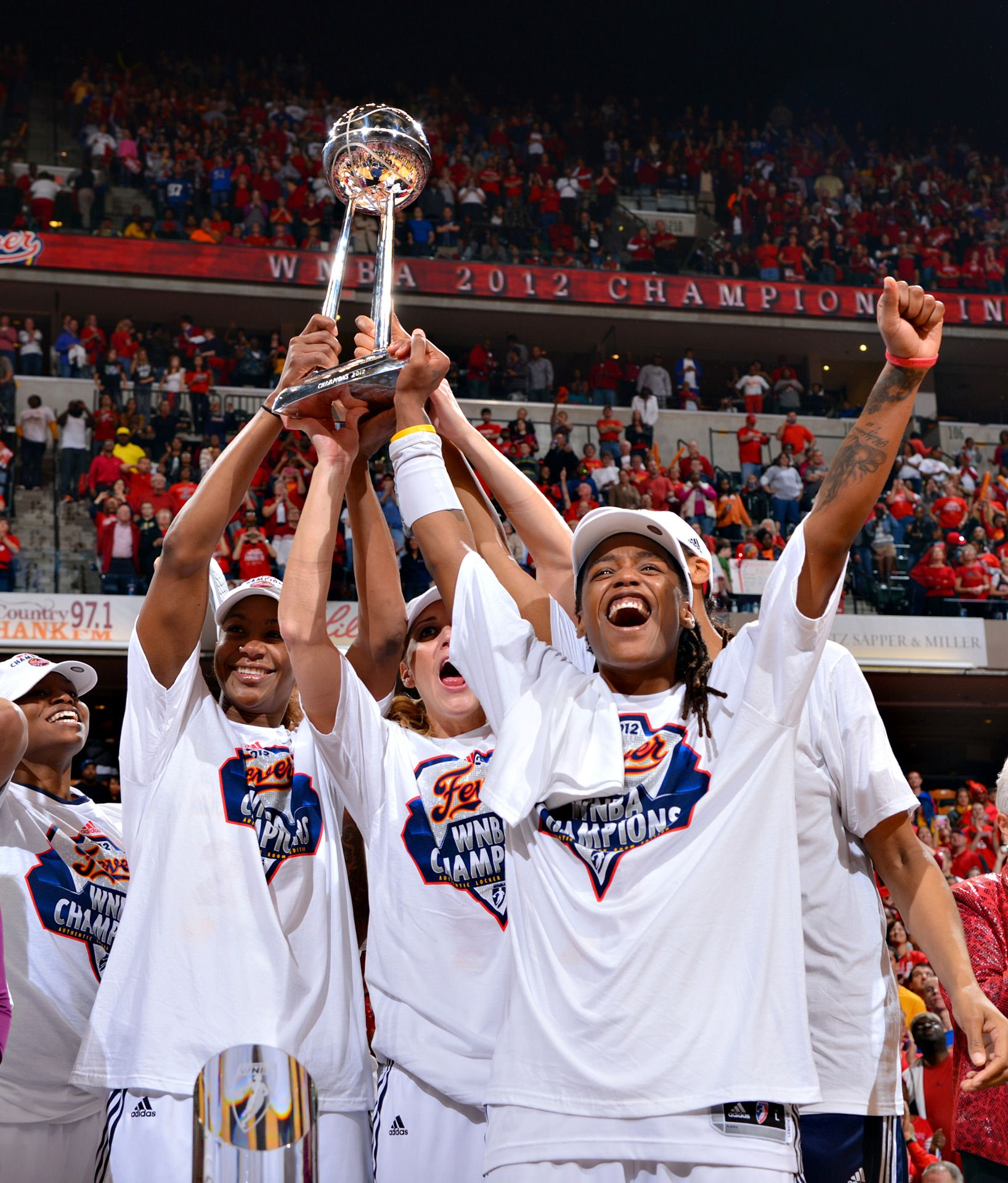 Because a trophy with many hands on it is how that trophy was earned. Together.   The Fever celebrate their 2012 WNBA Championship.
