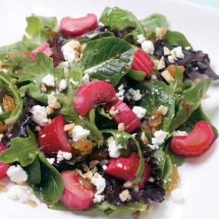 Roasted Rhubarb Salad  Rhubarb roasted for just a few minutes is a tart topping for a mixed green salad with raisins, walnuts and goat cheese.  @eatingwell #spring