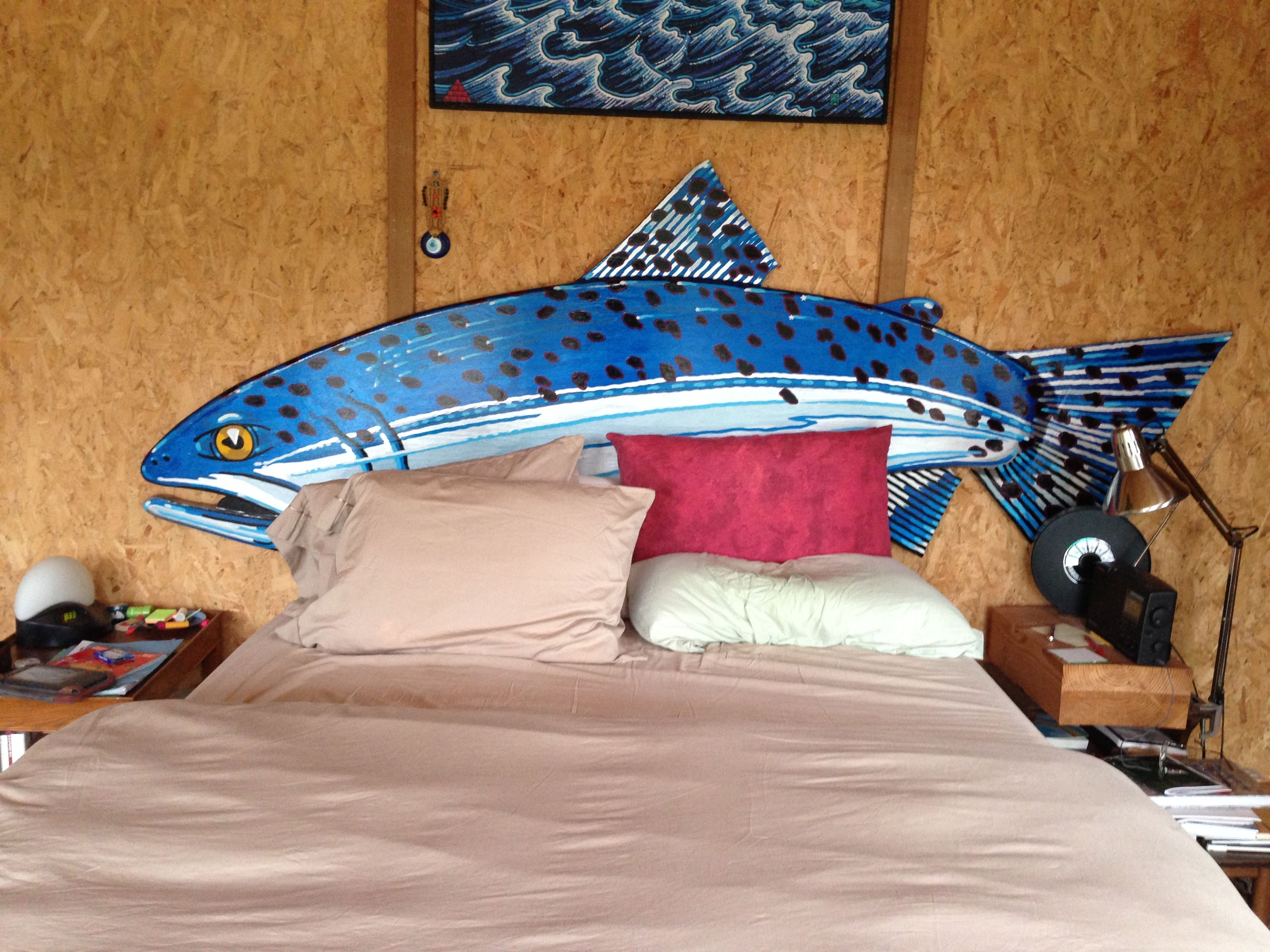 We commissioned the headboard from artist Frank Samuelson