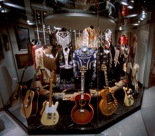 the country music hall of fame houses guitars rhinestone studded clothes and other music. Black Bedroom Furniture Sets. Home Design Ideas
