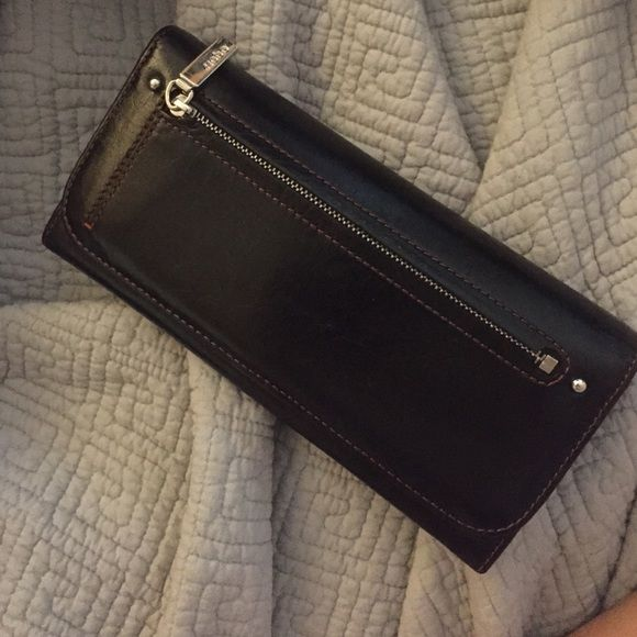 Black Hobo wallet Gently used and loved wallet, small scrapes but hardly noticeable. Inside of wallet is immaculate. Several slots for credit cards an zipper on the inside. HOBO Bags Wallets