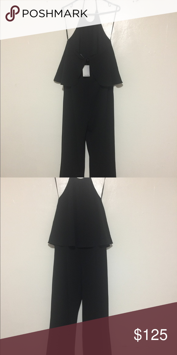 69c8fe7d9f9 Black Calvin Klein Jumpsuit open back. Cute Black halter back Jumpsuit.  Size 6