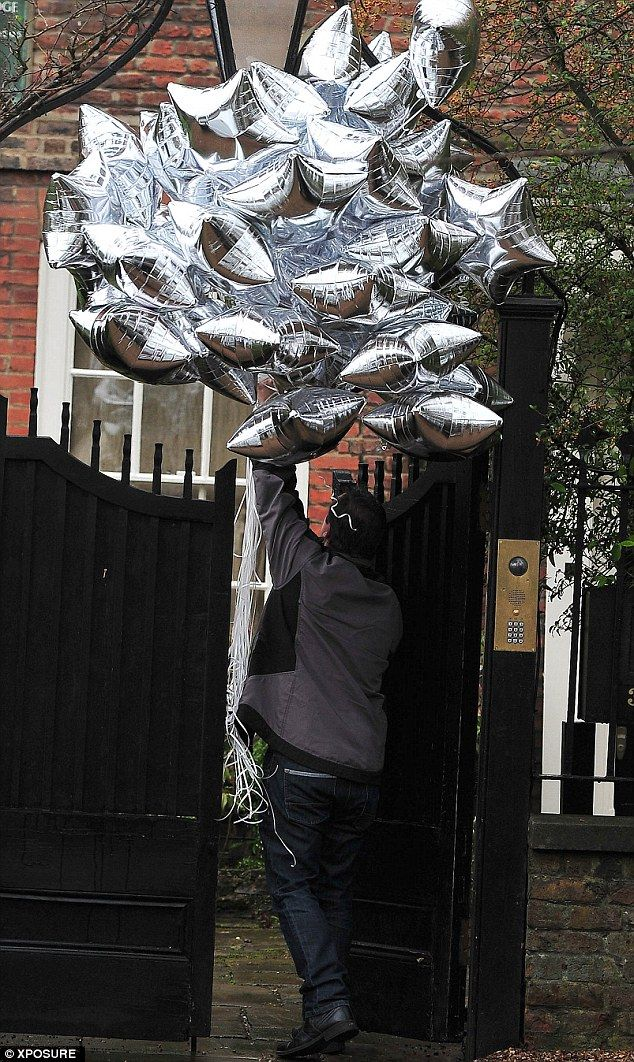 Special Delivery A Man Arrives With 40 Silver Balloons To Kate Mosss London Home On Wednesday
