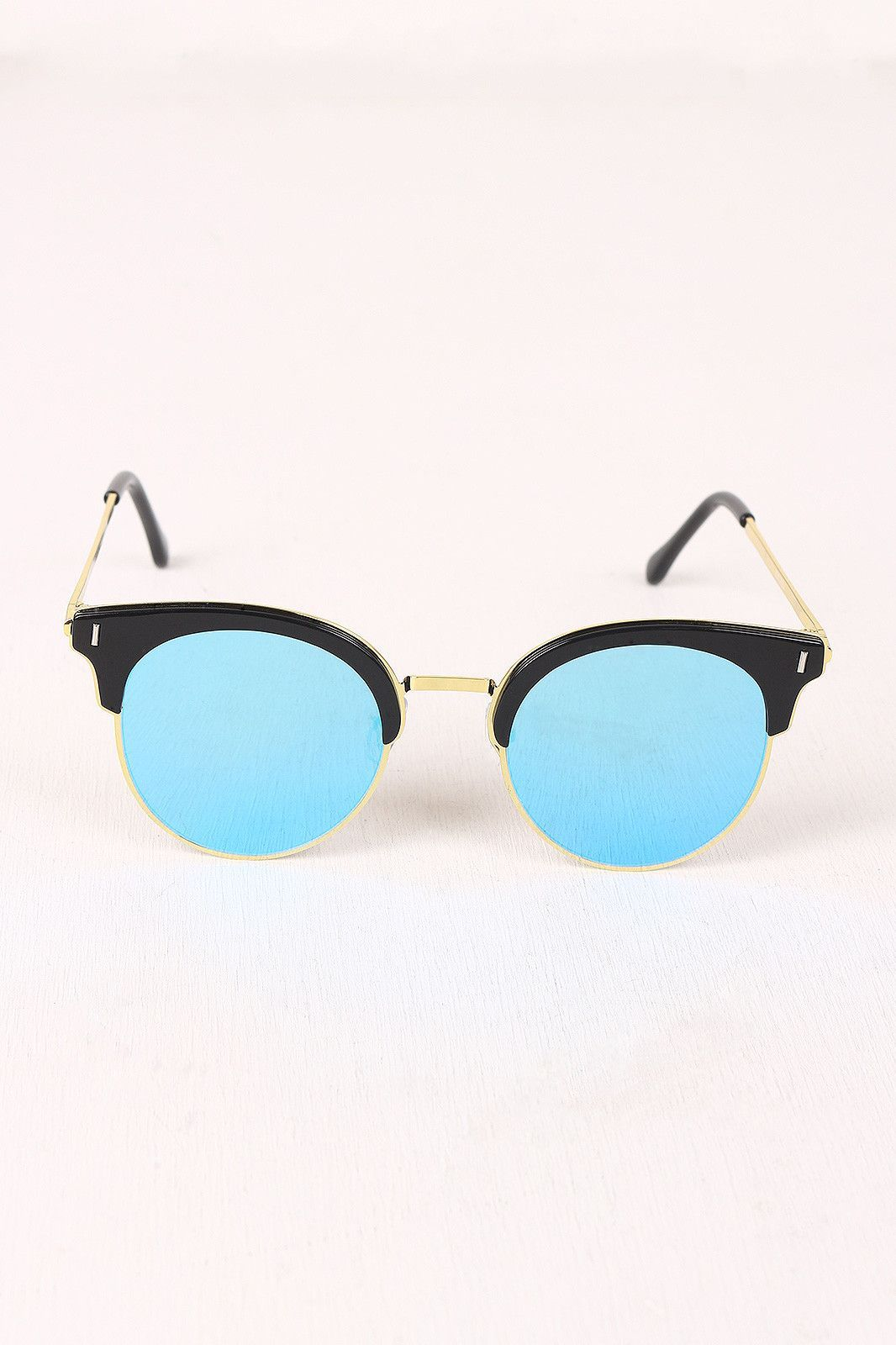 064663ae43 These clubmaster-style sunglasses feature a round mirrored lenses with  plastic brow detail