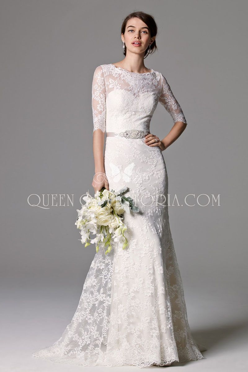 7a0342e1f85 This wedding gown of Lace is classic with 3 4 sleeves and a lace illusion  scoop neckline. Puddle Train.