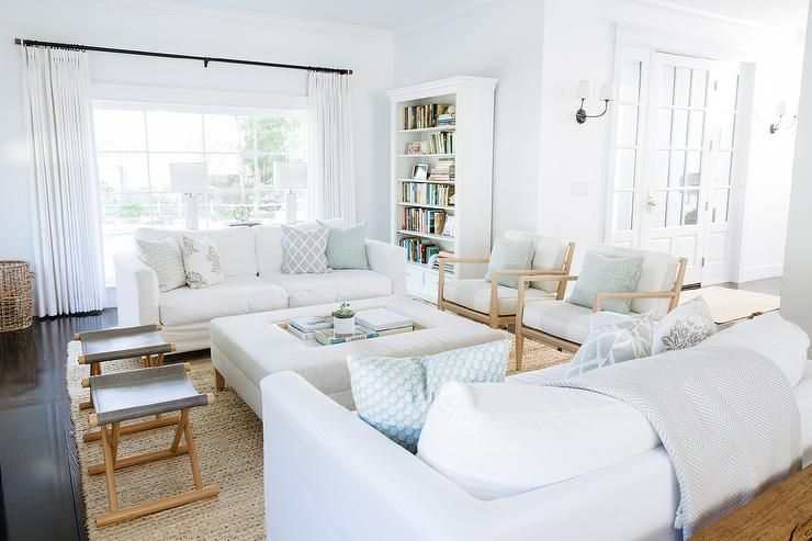 white slipcovered sofa living room color palette gray bright features sofas lined with and blue pillows facing each other across from a