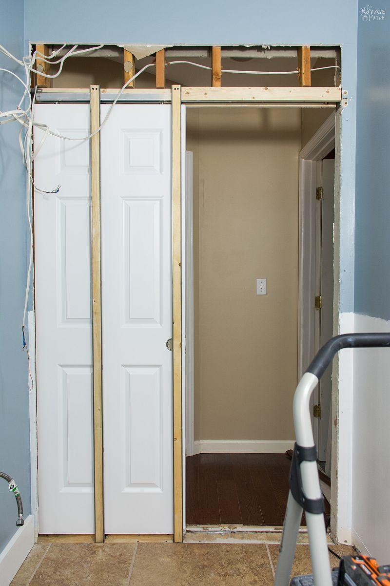 guest bathroom renovation - pocket door installation in