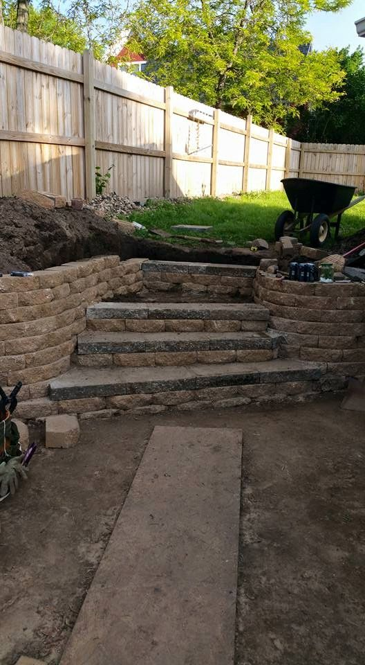 The start of our patio .. can't wait for the rest of the cobblestone to be placed. #patio #retainingwall #steps #terracestep