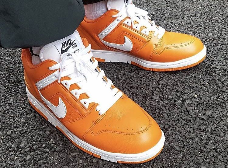 Supreme x Nike SB Air Force 2 Low Orange Blaze made of high-grade leather,  with an orange tie with white tongue, Swoosh and midsole, and the words