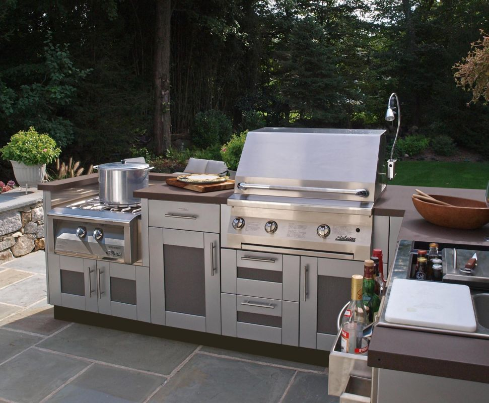 Stainless Steel Appliances And Paneled Cabinets By Danver Complete This Sleek Outdoor Kitchen Full Outdoor Living Kitchen Luxury Kitchen Island Outdoor Kitchen