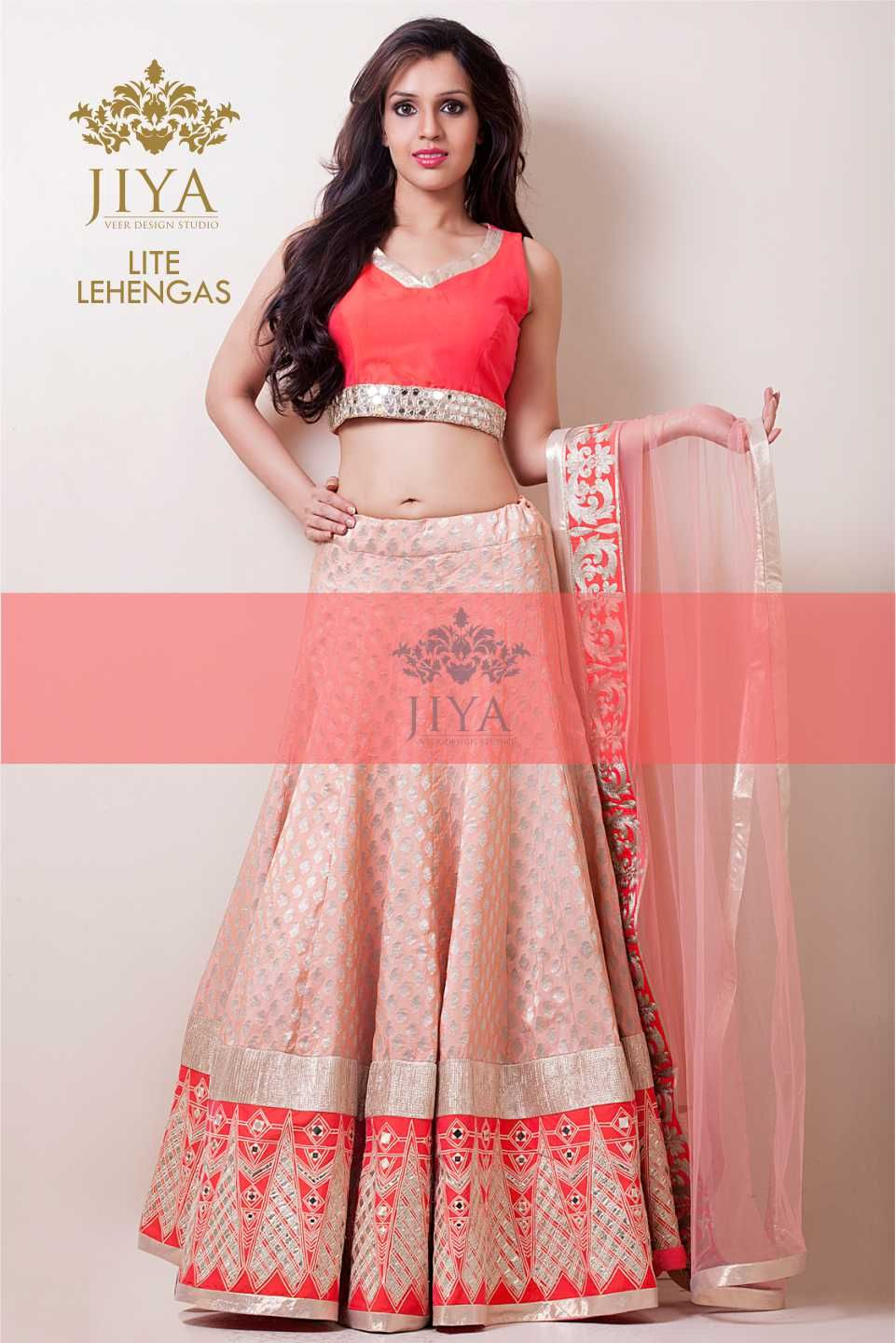 a7ae70edc88b A peach pink brocade lehenga with coral gotta patti border in indian motif.  Styled with a rawsilk coral blouse with a mirror border.